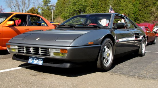 A Ferrari Mondial.  I'd dare say that there is no doubt about what decade this car is from, as the styling is very 1980s.