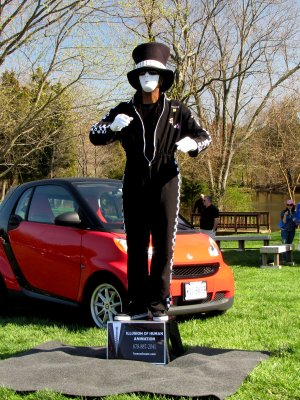 "While not a car, this person's ""robotic mime"" performance was quite impressive to watch.  This person would stand motionless for several minutes, and then change position in a way that made the movement appear mechanical in origin rather than being done by a living being.  They have a website, humanimate.com, where there are photos and videos of other performances, as well as a description of what robotic mime is."