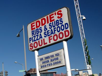 The sign at Eddie's Soul Food is the standard KFC design, minus the chicken bucket on top.