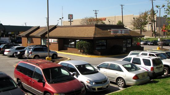 This 7-Eleven is a former 1980s-style Burger King. It would have looked similar to this when it was Burger King. According to Street View imagery, this housed a branch of the DC DMV until some time between July 2009 and July 2011. The only imagery that shows the building as a 7-Eleven is from this year, which makes me think that this was a recent change.