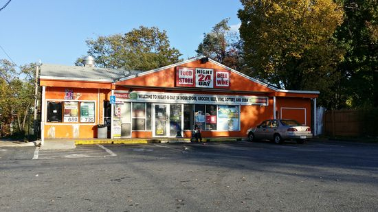 """This former 7-Eleven, on Benning Road SE near the DC line, is now Nite N Day Food Store. It's now orange, but the architecture screams """"7-Eleven"""", with the store's apparently reusing the original 7-Eleven sign frame."""