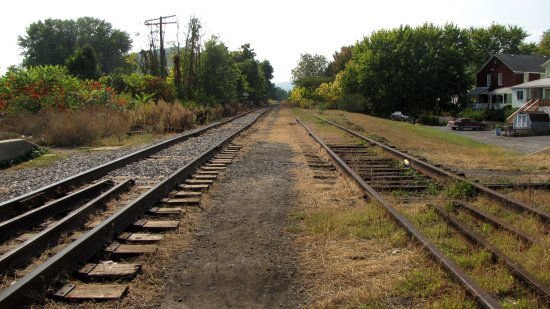 Western Maryland Scenic Railroad tracks in Ridgeley, leading to a rail yard.  This photo is a 180-degree turn from the previous one, thus the track on the left side in this photo is the one used for train movements.