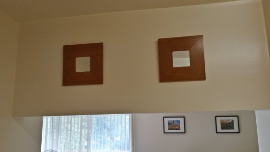 The Malma mirrors from IKEA on the kitchen side, stained brown.