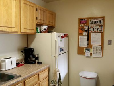 The bulletin board is now in the kitchen.  It makes far more sense to have this in the kitchen than in the living room.