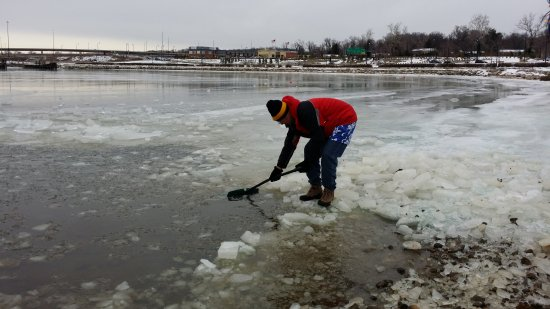 Shoveling ice off of the surface of the Potomac