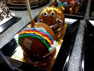 Caramel apples with frosting decoration