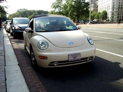 "DC Councilman Jim Graham's Volkswagen convertible parked in front of the John Wilson Building.  Considering our previous encounter on the road, I was tempted to leave a note on his windshield reading, ""Dear Jim, drive carefully.  Love, Ben.""  Considering the way he drives, I'm amazed that he's kept the car in one piece all this time."