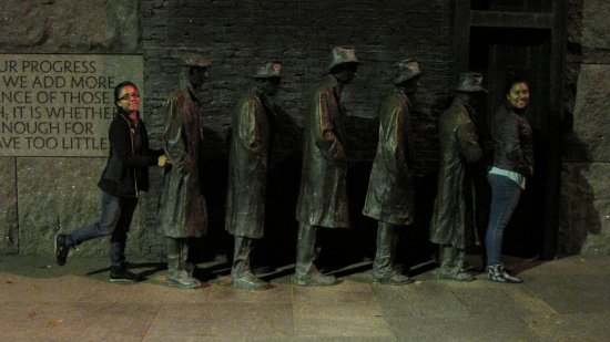 Suzie (at left) and Rocio pose with the row of people waiting in a bread line at the FDR Memorial.