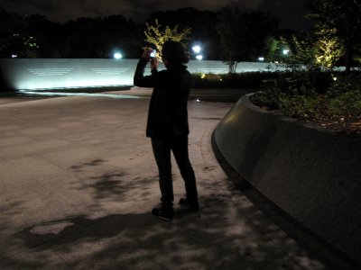 Suzie takes a photo at the MLK Memorial.