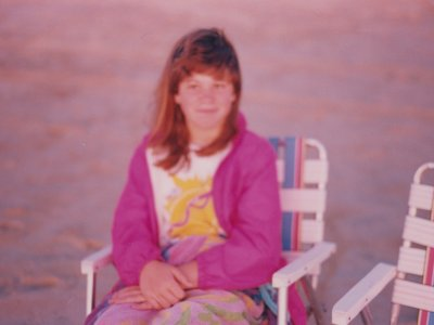Again in 1995 or 1996, Sis sits in a lawn chair on the beach and watches the sunrise.