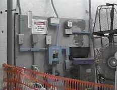 Still from a home video in 1997.  This is the electrical room at the Cape Hatteras Lighthouse, at the top of the stairs.  I want to take lots more pix of this room this weekend.