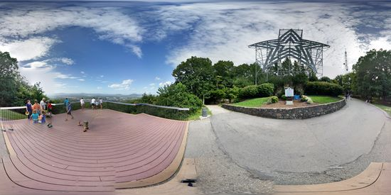 The Roanoke Star and overlook, while standing on a bench