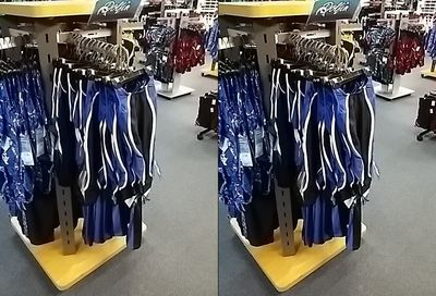 A rack full of Dolfin swimsuits.  It sort of reminds me of the suit that my friend Suzie wears, but she wears Nike.
