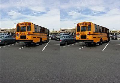 School bus 13514 parked across four spaces