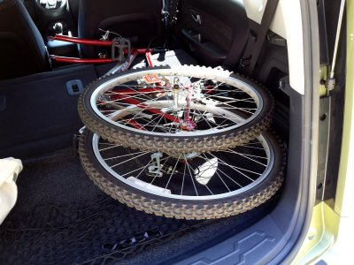 Fits perfectly in the back of my car with the front wheel detached, however.