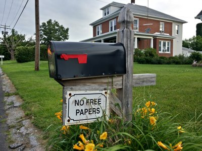 """NO FREE PAPERS"" sign on a mailbox"