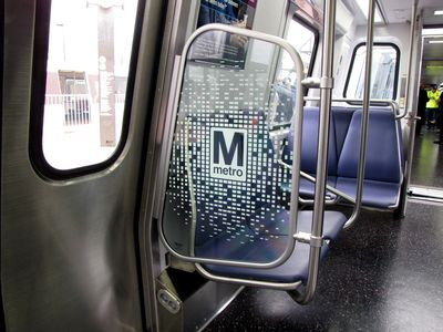 Like in other car series, where there is a seat adjacent to a door, there is a windscreen.  Unlike the 1000 through 5000-Series, these new windscreens are not full-height, and unlike the 6000-Series, this windscreen is both off the floor and higher than head height for the average seated passenger.