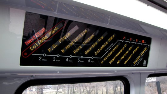 Electronic strip map.  This is over the middle window on one side of each half of the car, where a spot for signage exists on other cars.  It lists the next six stops, then four more stops of varying distances, and then the final station on the line.  The map is shown displaying the stops for Green Line service to Branch Avenue.