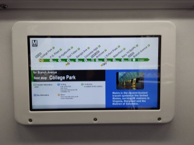 This is a completely new feature on the 7000-Series cars.  This is an LCD screen showing service information, replacing the system map on the evacuation instructions sign.