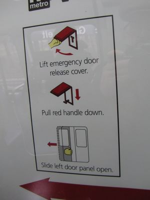 The graphics for the door release handle are carried directly over from the earlier evacuation maps.  Note that the evacuation handle shown is the style used on the 1000-Series cars.  Considering that the 7000-Series will replace the 1000-Series cars, and the other car series use a different style and color of door release handle, I hope that this graphic is updated on the final version of this sign before more cars are outfitted with it.  I can almost guarantee that this was an oversight, but it will be an obsolete illustration following the retirement of the 1000-Series cars.