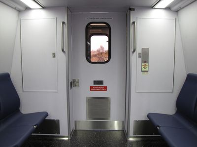 This is the cab end of car 7006.  Note that the large window in the cab is now gone, and understandably so - it is my understanding that the large windows looking towards the interior of the car caused a lot of glare in the cab.  While the normal railfan window has been eliminated, there is a view through the cab door window.