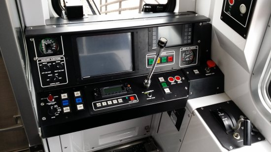 Operator's console in the cab.  The large screen in the middle and the smaller screen to the right are new, and a number of the train controls are in different places than before.