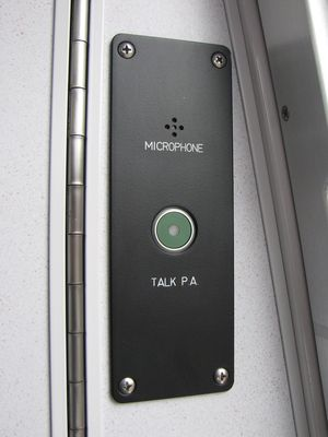 Left-side door switches, emergency stop plunger, and PA microphone.  Unlike in previous car series, the controls are not behind a door, and this area contains no seat, and will most likely be unavailable to passengers.