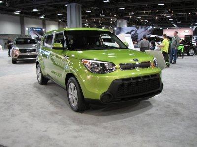 A green Kia Soul