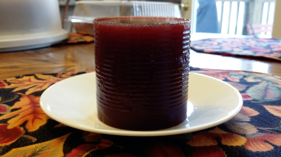 Cranberry sauce on a plate, still very much can-shaped.