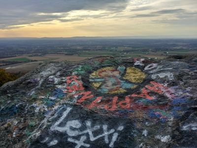 View facing approximately west, plus peace sign graffiti.
