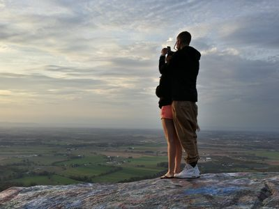 A couple takes photos of the view with their respective phones. View facing approximately northwest.