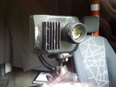 The camera unit inside the van, viewed through the windshield