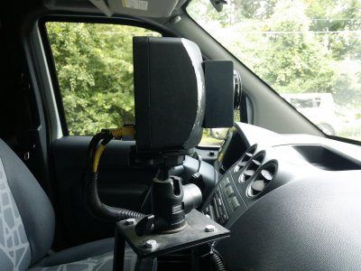 The camera unit inside the van, viewed through the passenger-side window