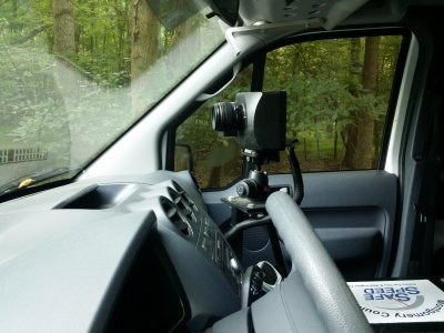 The camera unit inside the van, viewed through the driver-side window