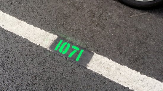 """""""1071"""" painted on the ground next to the speed van"""