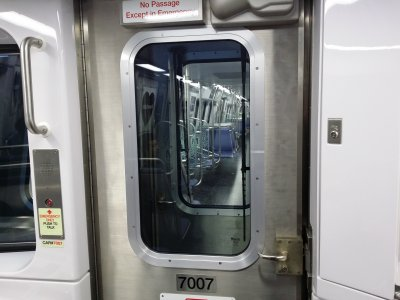 This is something that I missed during the preview at Greenbelt last year.  The bulkhead doors have windshield wipers on them.  I was at first perplexed about why the doors would have wipers on them, but then I remembered the hostler controls (behind that panel to the right), and it all made sense.