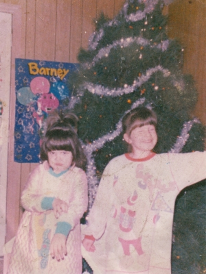 "The girls are older in this photo, with ""93"" written on the back. Assuming December 1993 based on the presence of the Christmas tree."