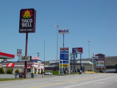 North side of US 30, facing east, from halfway up the strip. Taco Bell, Exxon, KFC, Mobil, and Gateway Travel Plaza. Not much has changed here, other than the closure of the KFC and the conversion of the Mobil station to Valero.