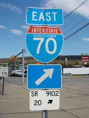 Signage for Interstate 70. I believe that the numbers on the white sign at the bottom are part of Pennsylvania's Location Referencing System (LRS).