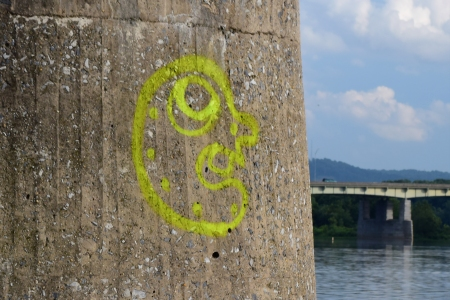 Graffiti face on one of the piers near the shore.
