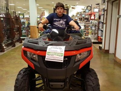 Elyse rides a four-wheeler