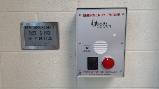Remember how I wrote a quote article about these back in 2000? They have been replaced! In their place are the standard JMU emergency phones, where one press of the button calls campus police. This seems a better solution than the old intercom system for rescue assistance. Those old buttons would get hit so often that no one paid any attention to them. If someone hit one, it sounded an alarm at the main entrance, someone would press a button to stop the alarm, and that was that. Then campus police would just reset the system with a key when they were nearby, but even they knew that the system was worthless. The likelihood that someone would actually respond to a legitimate activation of the system via the old intercom was slim to none. The new implementation, where it contacts campus police directly, makes more sense.