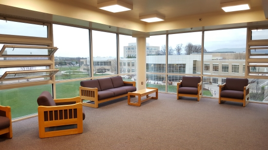 TV lounge, fourth floor, upperclass side. The College Center (now Festival Student Center) is in the background.