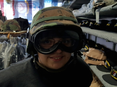 Trying on a helmet and goggle set.
