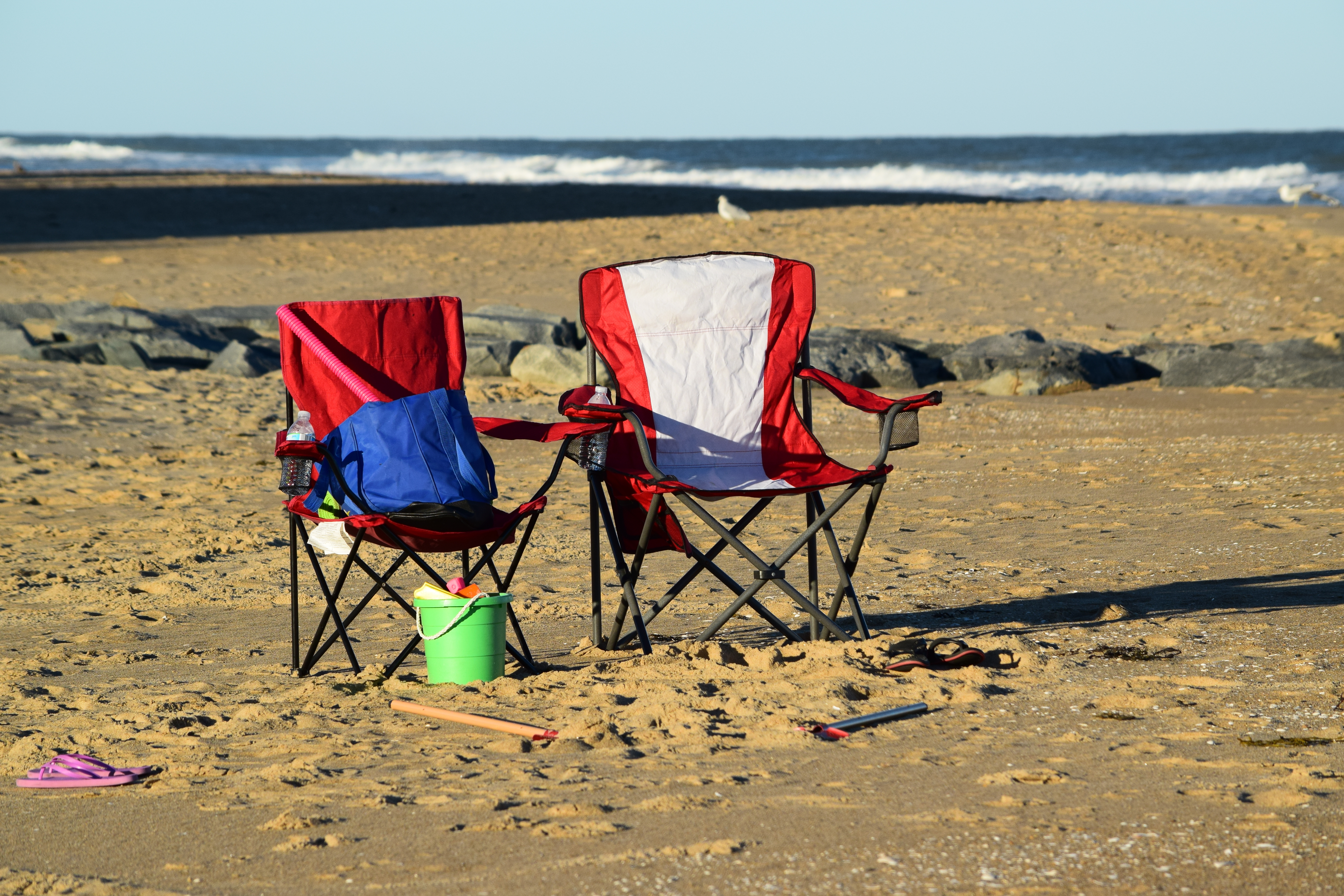 Two chairs set up on the beach.