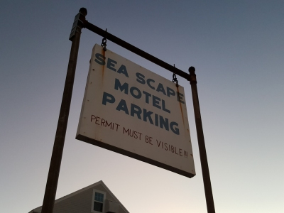 "I don't know about you, but this sign struck me as tacky. I get the need for lodging facilities to preserve their parking lots' spaces for their guests, but the ""PERMIT MUST BE VISIBLE!!!"" (with three exclamation marks) part just rubs me the wrong way. This could have been done far more tastefully."
