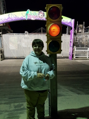 Elyse poses with the traffic light.