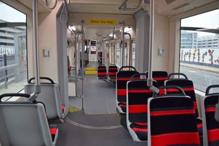 Streetcar interior. Note that the car is bi-articulated, with the ends pivoting around the center section. Imagine a stretched version of the hinge area on an artic bus. Also compare to Baltimore's LRVs, which only have one articulated joint.