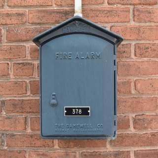 Gamewell fire alarm box on the side of a building