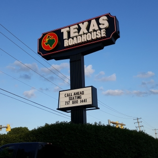 Texas Roadhouse signage in a Shoney's frame